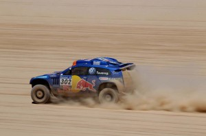 compete during the fourth stage of the 2011 Argentina-Chile Dakar Rally between Jujuy, Argentina, and Calama, Chile, Wednesday, Jan. 5, 2011. (AP Photo/Natacha Pisarenko)
